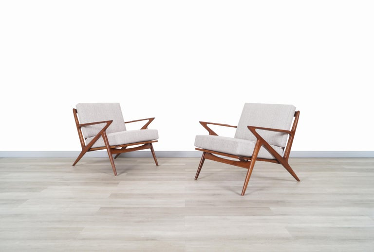 """Stunning pair of Danish modern lounge chairs designed by Poul Jensen for Selig in Denmark, circa 1960s. Known as the """"Z"""" chair for its exclusive armrests that connect to the legs and give the illusion of a letter Z. These chairs stand out for the"""