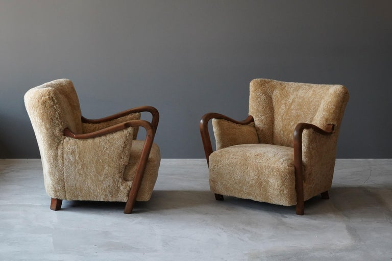 Scandinavian Modern Danish Modernist Designer, Lounge Chairs, Sheepskin, Stained Beech Denmark 1940s For Sale