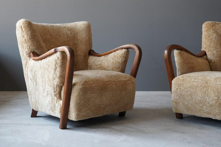 Mid-20th Century Danish Modernist Designer, Lounge Chairs, Sheepskin, Stained Beech Denmark 1940s For Sale