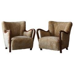 Danish Modernist Designer, Lounge Chairs, Sheepskin, Stained Beech Denmark 1940s