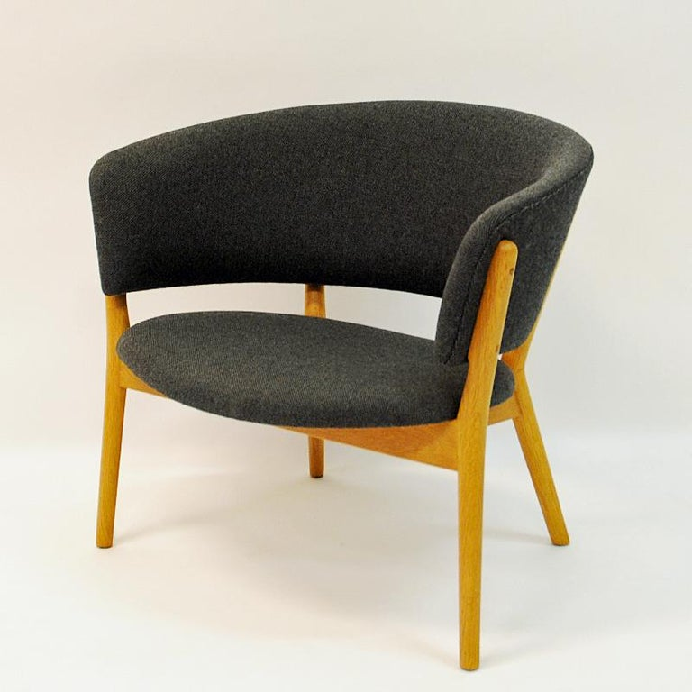 This lovely round shaped oak chair is a timeless Danish modern classic icon. Model ND83 was designed in 1952 by the famous designer Nanna Ditzel (1923 - 2005) for Søren Willadsen, Denmark. The clean lines and small scale makes the ND83 model a very
