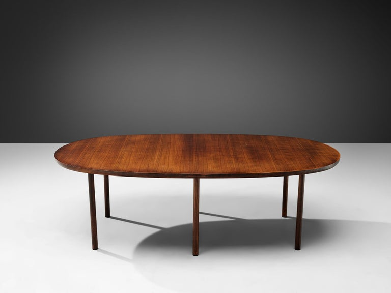 Dining table, rosewood, Denmark, 1960s  A lovely oval dining table rosewood. The grain of the top of this table is striking, showing variety of dark and lighter tones, for which rosewood is well-known. The design of the table is Classic and simple.