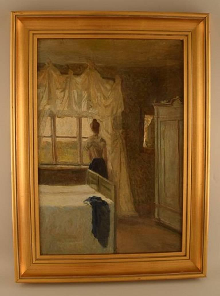 Danish painter circa 1890s: Bedroom interior with a woman by the window.  Unsigned.  Oil on canvas.  Measures: 52 cm. x 35.5 cm. In perfect condition.