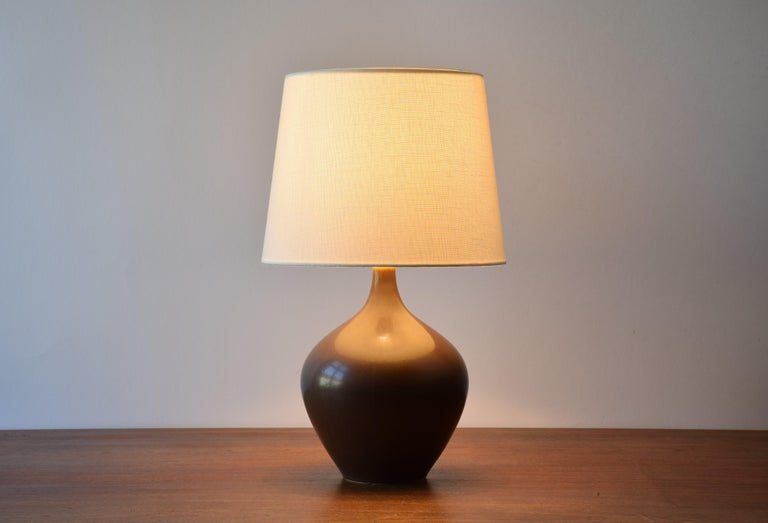 Midcentury budded table lamp from Danish Palshus with brown haresfur glaze. The lamp was designed by Per Linnemann-Schmidt and produced circa 1950s.  Included is a new lampshade designed in Denmark. It is made of woven fabric with some texture and