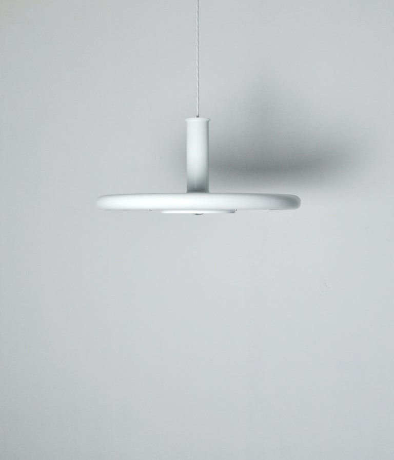Danish pendant by Fog & Mørup, model 'Optima'. Design Hans Due.  Pendant in white metal, white and red inner shade. Optima is specially designed for silver bulbs, thus obtaining the flattest possible fitting, where the shade covers only a minimum