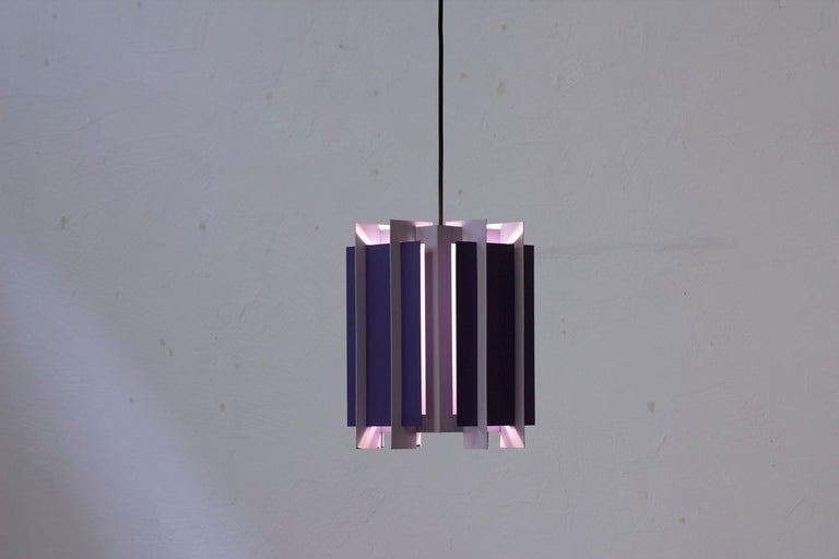 Pendant lamp designed by Bent Karlby. Manufactured by Lyfa in Denmark during the 1960s. Made from metal sheets lacquered in two tons of purple. Rewired with black fabric cable.