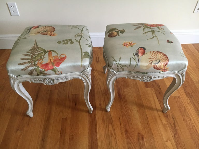 Beautiful pair of good sized Danish painted wood Rococo style stools from the 1930s, carved and having a scallop motif. Newly upholstered in the delightfully whimsical Bullfinch & Nautilus silk or cotton blend by Scalamandre. Ready for installation.