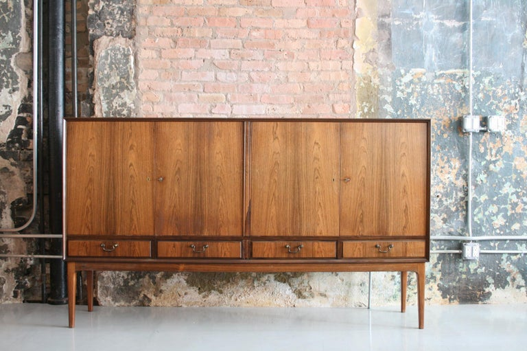 Danish rosewood credenza after Ole Wanscher circa 1960s having fine dovetailed drawers and brass pulls. Excellent condition.