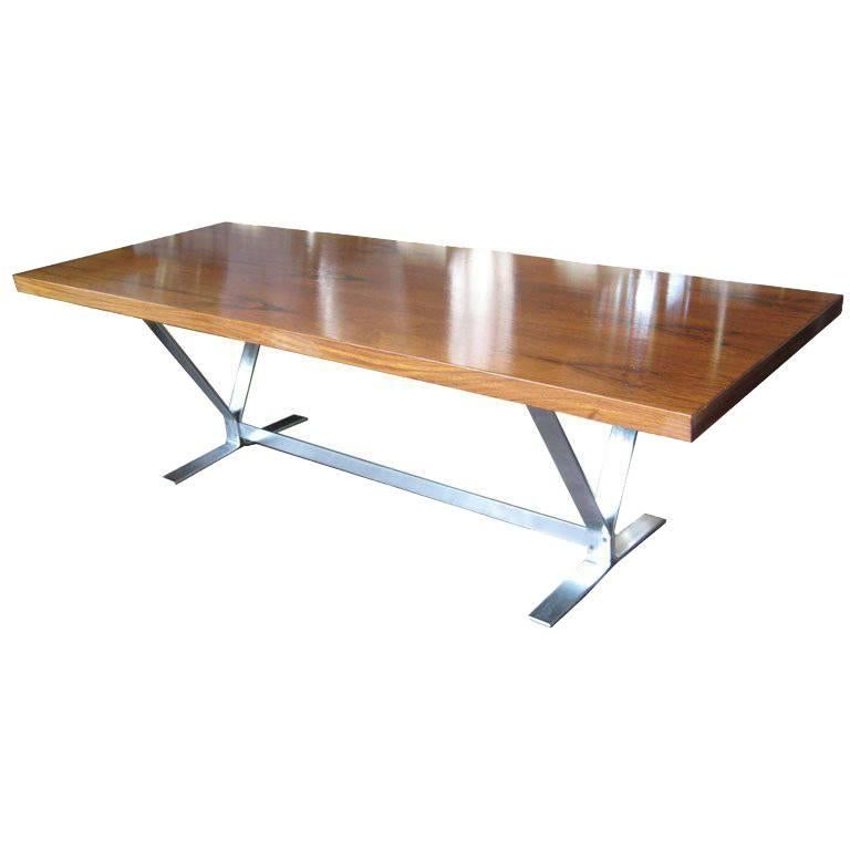 Chic coffee table with bookmatched rosewood top on brushed flatbar steel base. Design by architect Georg Thams.