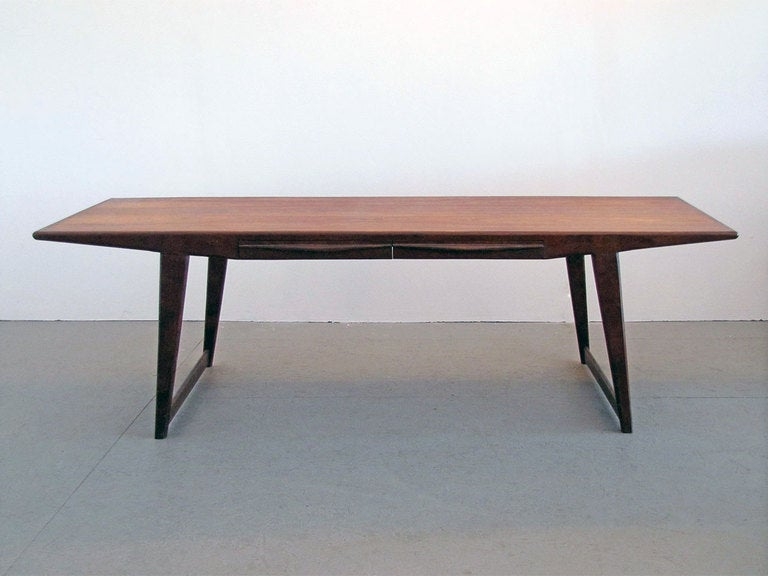 Beautiful rosewood coffee table by Johannes Andersen with two sculptural drawers seamlessly integrated in the tabletop.