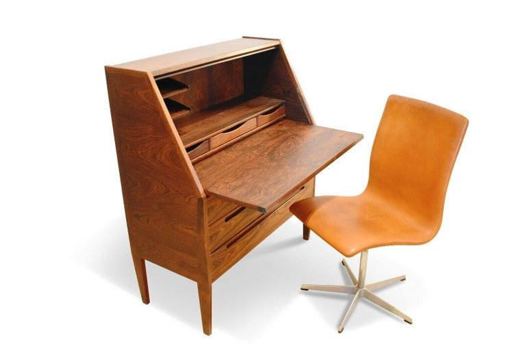 Beautiful and rare Danish rosewood secretaire by Nils Jonsson for Møbelfabrik, 1960s.   Very stylish and practical piece, perfect for smaller spaces. The fall flap front encloses a writing space with three shallow drawers and a shelving section.