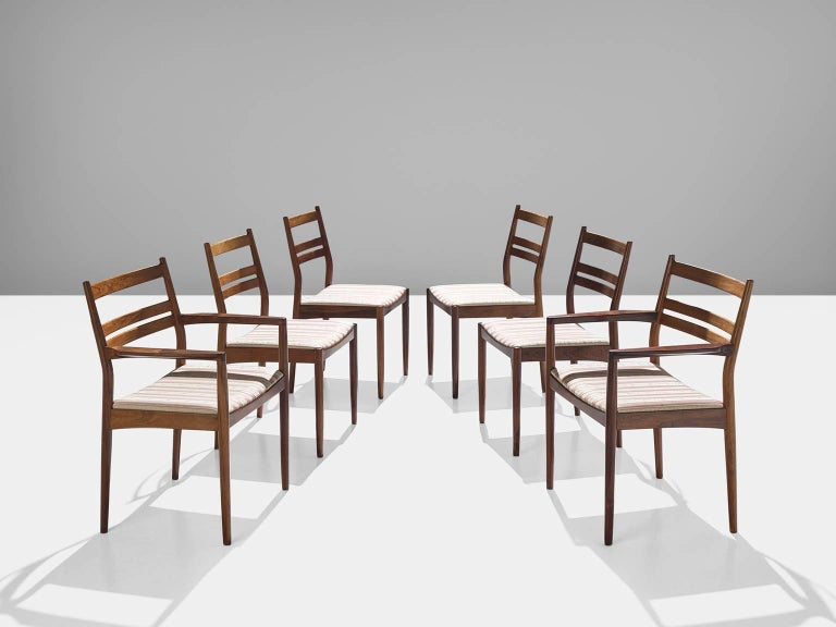 Dining chairs, rosewood, striped wool, Denmark, 1960s.  This set of dining chairs is functional and well-made and also manage to spark your attention when placed in a dining room. The set exists of four chairs without armrests and two with