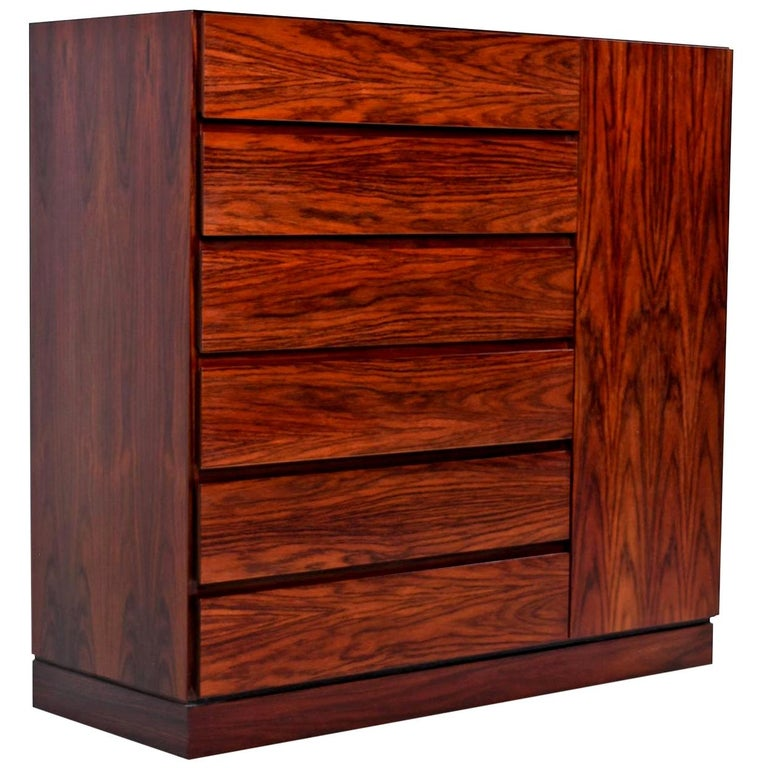 Scandinavian inspired minimalism at its best. The rosewood veneers are rich and dark with flaring cathedral grain. High end Scandinavian cabinet shop construction inside and out with dovetail joinery on the solid beechwood interior drawers. Designed