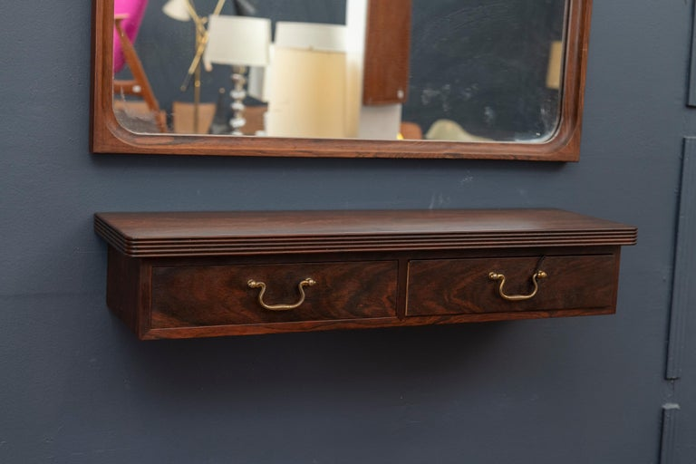 Danish rosewood console mirror with matching two-drawer shelf. Excellent quality construction and condition.