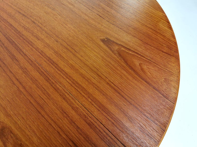 Danish round teak dining table   High quality made Danish dining table, circa 1960s. Complete with the original quality control tag.  Dimensions (cm): 120 D x 73 H x 120 W (no leaves for extending)  Condition: Excellent. Minimal signs of