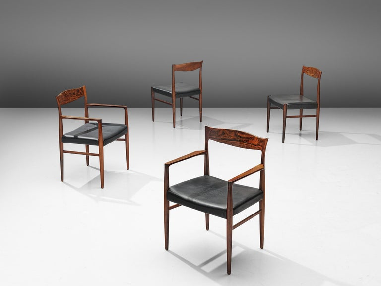 Set of 4 dining chairs, rosewood and leather, Denmark, 1960s.  Elegant set of Danish chairs featuring a rosewood frame. The seat is slightly wider than the usual chair and the backrest has a subtle curve to it. The set consist of two armchairs and