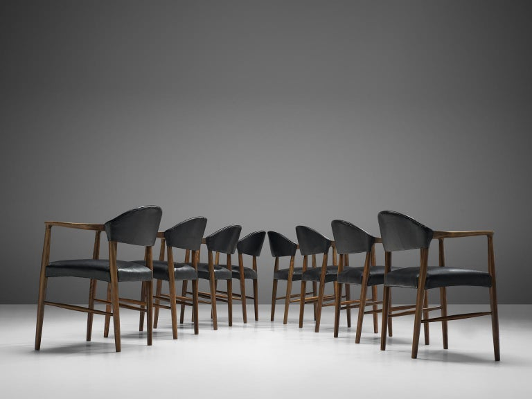 Kurt Olsen, set of 8 dining chairs, leather and beech, Denmark, 1958.  Very comfortable dining chairs, due to well-shaped armrests and ergonomic proportions of the back and seat. The sculptural back is very attractive, as the beautifully curved