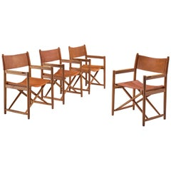 Danish Set of Four Safari Chairs in Cognac Leather and Oak