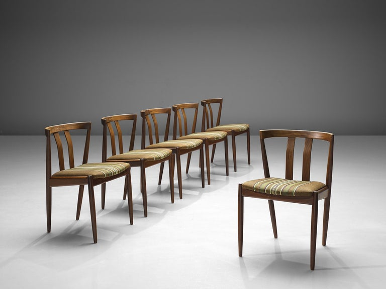 Six chairs, teak and wool, Denmark, 1960s  Elegant set of six Danish dining chairs featuring an open back with two slats, diagonal back legs that run all the way through to the backrest. This set is playful and dynamic yet also bears traits of