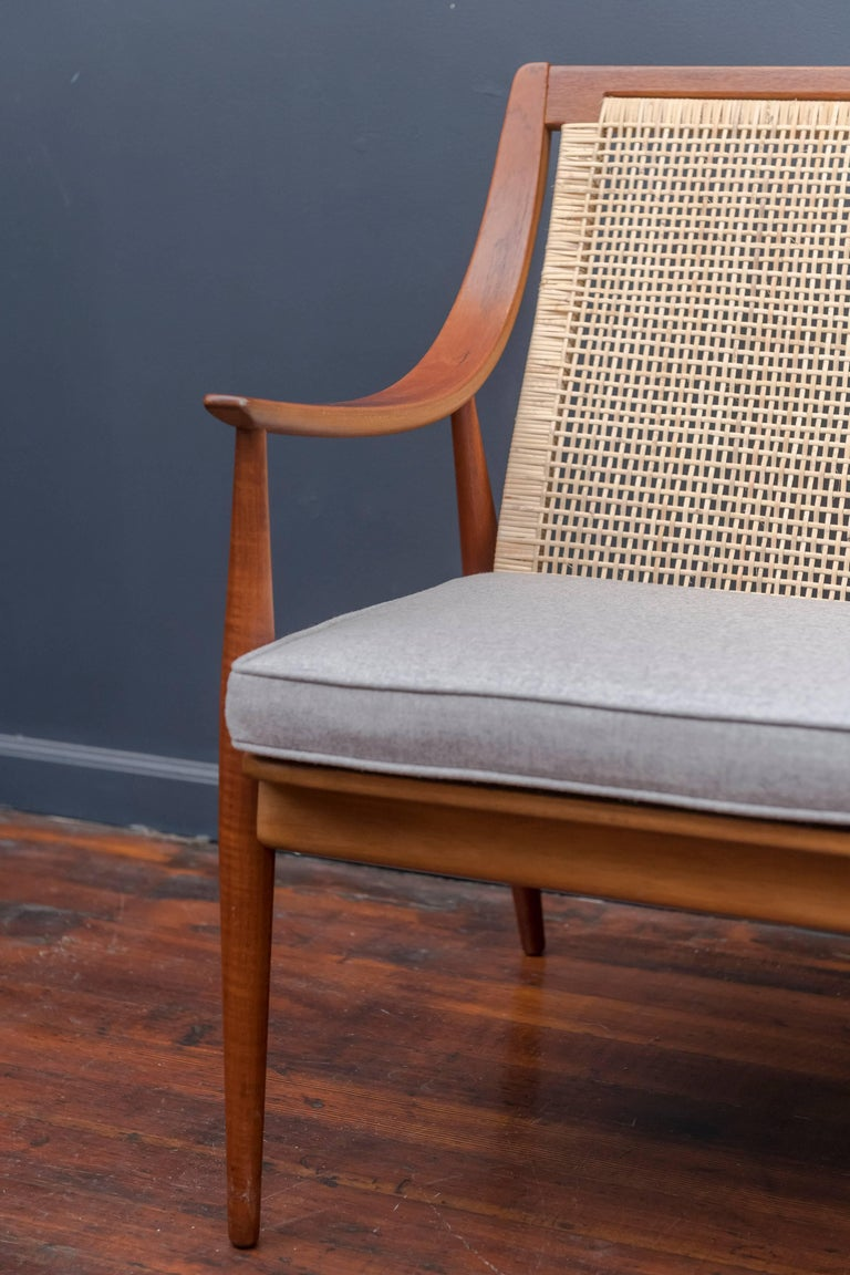 Beautiful Danish teak sofa designed by Peter Hvidt and Orla Mølgaard-Nielsen for France & Davoriksen, Denmark. Newly caned and upholstered, in excellent condition.
