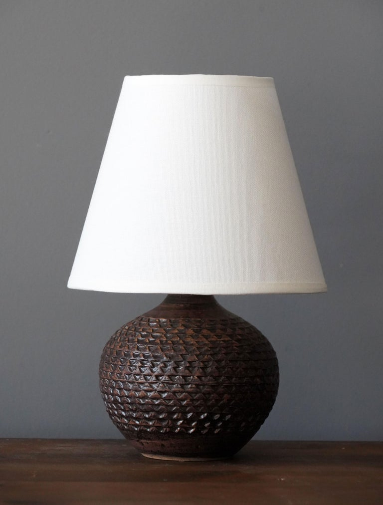 A small table lamp produced and design by unknown Danish studio potter.