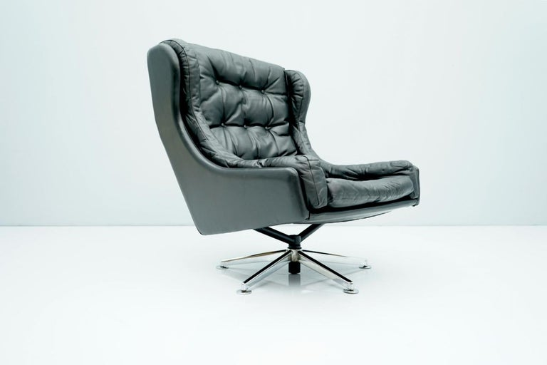 Danish Swivel lounge chair in black leather, 1960s. Good to very good condition.