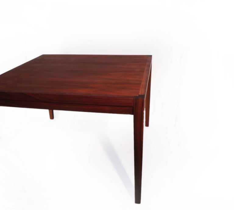 This Danish square teak coffee table has a beautiful grain across the top and lovely contrasting end grain corners. It has recently been refinished to return it to the beautiful shape it was in at the beginning of its life. This table is