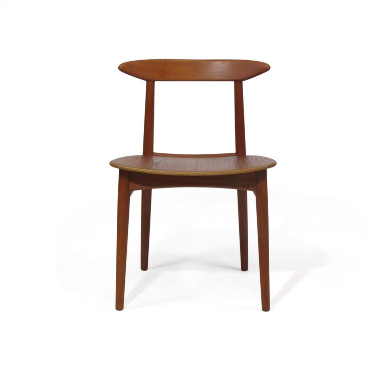 Oiled Danish Teak Dining Chairs with Wooden Seats For Sale