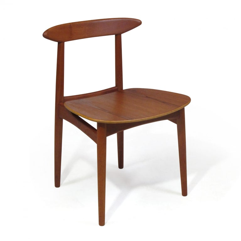 20th Century Danish Teak Dining Chairs with Wooden Seats For Sale