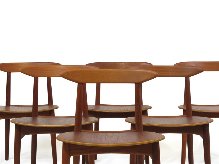 Danish Teak Dining Chairs with Wooden Seats For Sale 4