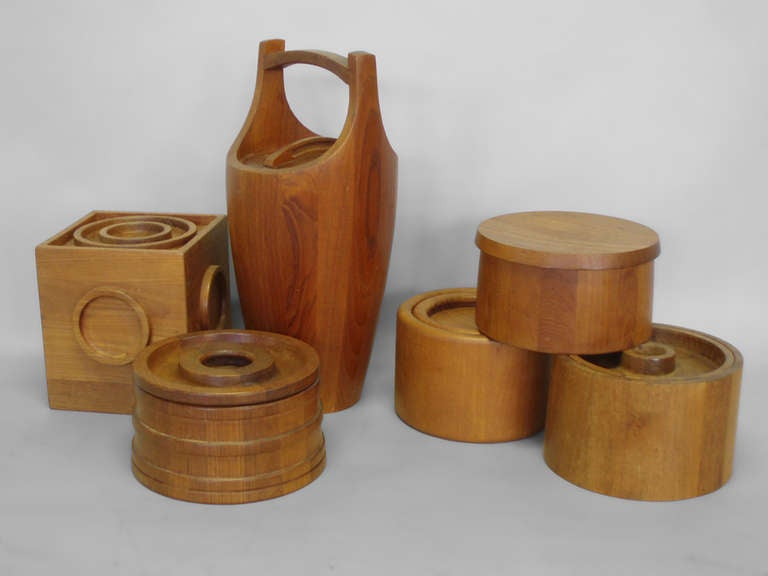 Collection of six Danish teak ice buckets by Jens Quistgaard for Dansk and Nissan. Measures: Tallest 19.25