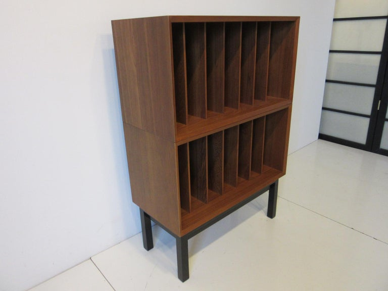 A teak wood Danish record storage cabinet / case with 14 slots at 3.75