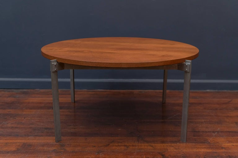 Unusual Danish teak and metal round coffee table. High quality craftsmanship and design in very good original condition with a light patina to the metal base.