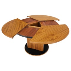 Danish Teak Round Expandable Table with Three Self Storing Leaves