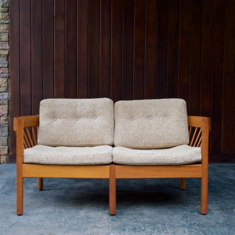 The sofa frame is strong, and without looseness, with a wonderful time worn patina. Original fabric cleaned with new foam inserted. Very comfortable, and the cushion webbing on the frame is holding fine.  The architect Jørgen Bækmark (1929) was