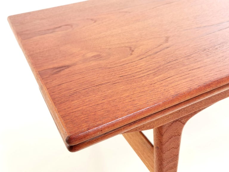 Metamorphic dining table  A 1960s teak metamorphic dining table by Trioh.  Know as the elevator table, and the innovative design sees the coffee table transform into a dining table capable of seating six people. Extra leaves are concealed