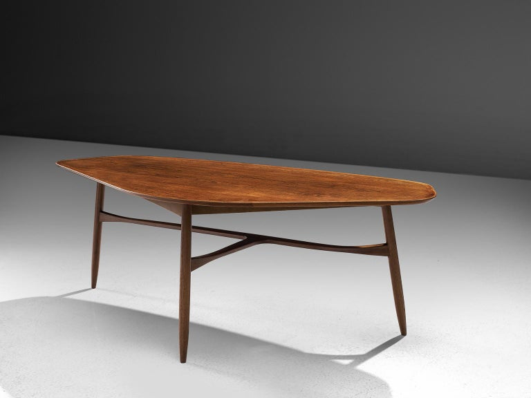 Coffee table, teak, Denmark, 1950s.   This freely shaped coffee table with three thin tapered legs is part of our Scandinavian midcentury design collection. The legs of the table are beautifully shaped and show high attention to detail, especially