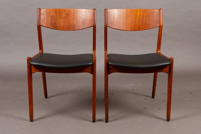 Danish vintage teak dining chairs, 1960s, set of 2. Pair of Danish dining chairs in solid teak with curved backrests. Classic Mid-Century Modern design from Danish manufacturer Sorø Møbelfabrik. Seats have been reupholstered with quality