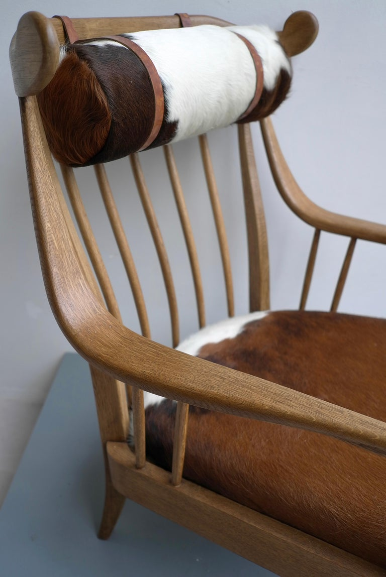 Danish well crafted Cowhorn lounge chair in solid oak with cowhide and nekroll.