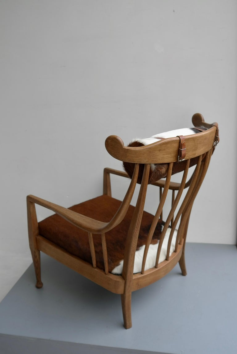 Mid-20th Century Danish Well Crafted Cowhorn Lounge Chair in Solid Oak with Cowhide and Nekroll For Sale