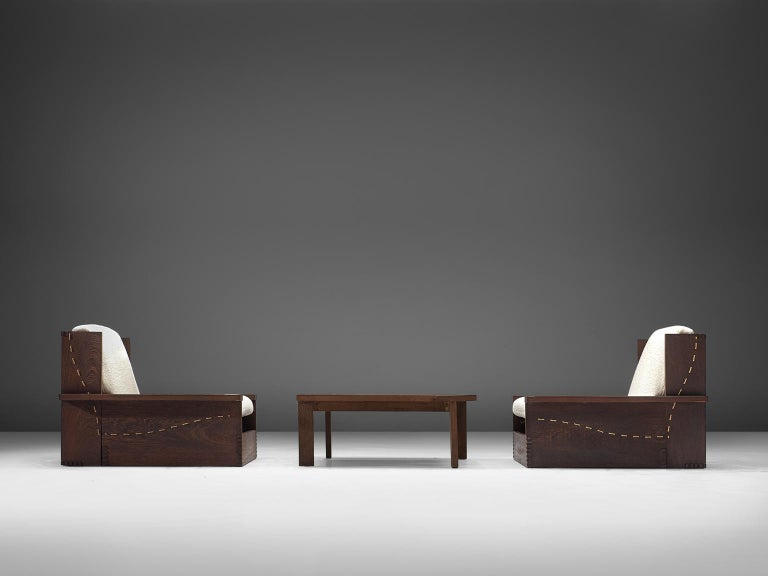 Lounge chairs and coffee table, wenge and white wool, Denmark, 1960s-1970s.  This modest, simplistic set of wengé chairs has a very robust yet detailed details. The cushions are reupholstered with a thick white woollen Pierre Frey. The design of