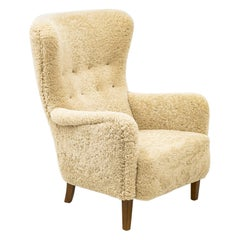 Danish Wing Back Chair with Sheep Skin in the Manner of Frits Henningsen