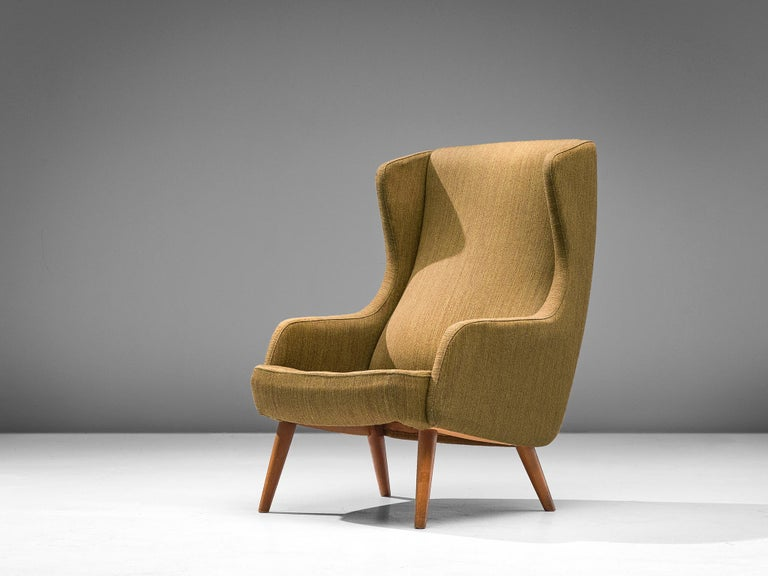 Fritz Hansen, wingback chair, in oak and fabric, Scandinavia 1950s.  High back chair in a mustard fabric upholstery. This chair shows the characteristics of the Scandinavian Modern style and is manufactured by the master cabinetmaker Fritz Hansen.
