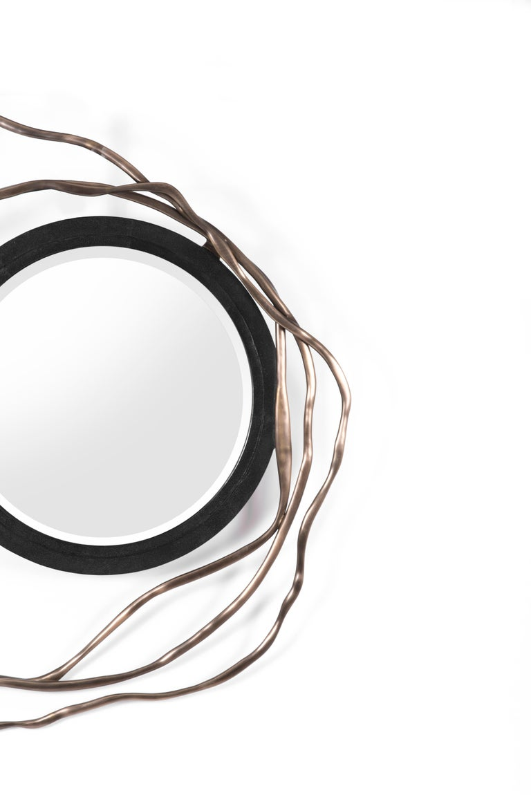 The Dargelos Mirror is a statement piece with its ethereal inspired roots. The intertwinement of the twisted bronze-patina brass wires, against the circular black shagreen frame of the mirror creates a truly whimsical feel, white retaining it's