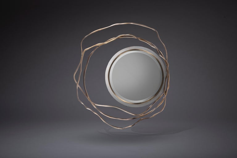 The Dargelos mirror is a statement piece with its ethereal inspired roots. The intertwinement of the twisted bronze-patina brass wires, against the circular cream shagreen frame of the mirror creates a truly whimsical feel, white retaining it's