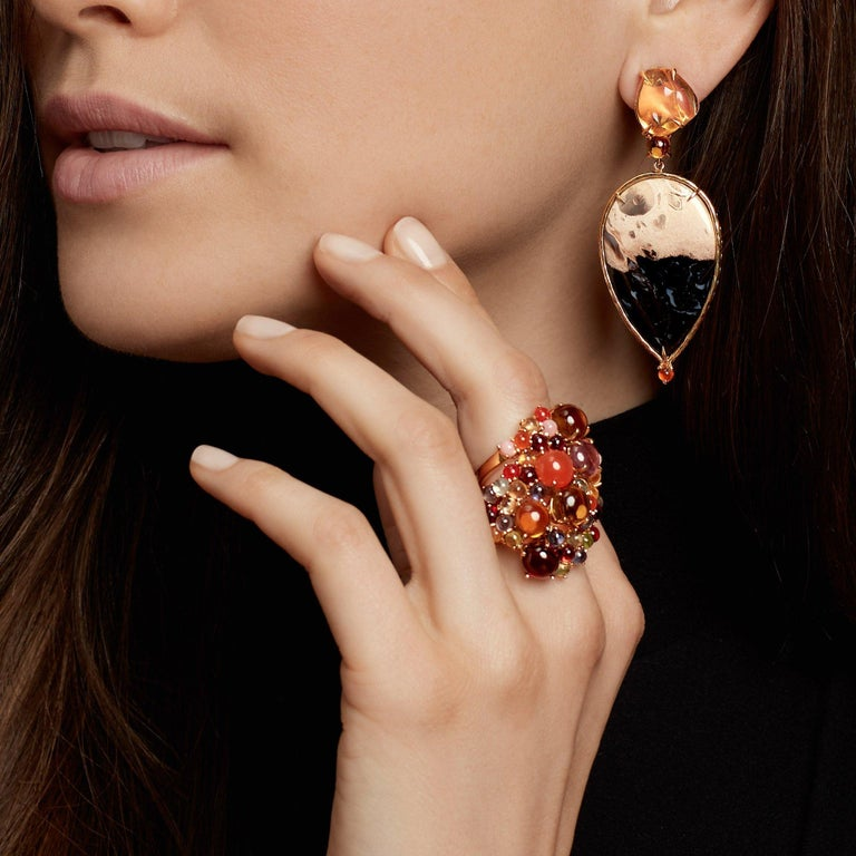 Stunning when stacked, yet striking on their own as singles. The Dagny Ring is offered in an array of mouthwatering stones – shown here with cabochons of yellow citrine and pink tourmaline with medley sides of pink opal, carnelian, citrine,