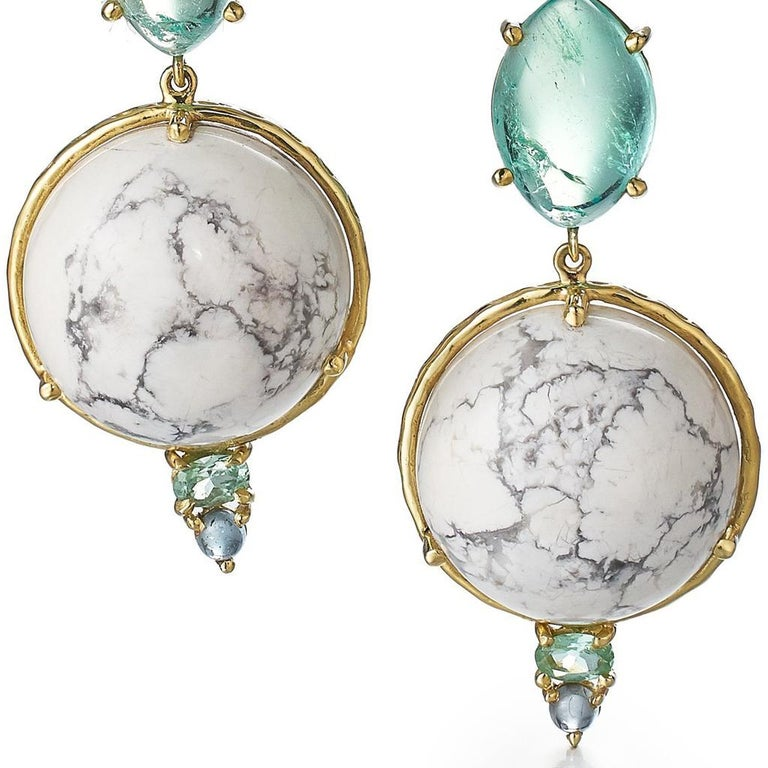 Inspired by the rocks in Milos, Greece, these earrings feature round opalescent aquamarine cabochons, nearly 12 carats of marquise-shaped emerald cabochons, white howlite cabochons with veins of grey, and tourmaline accents. These earrings are part