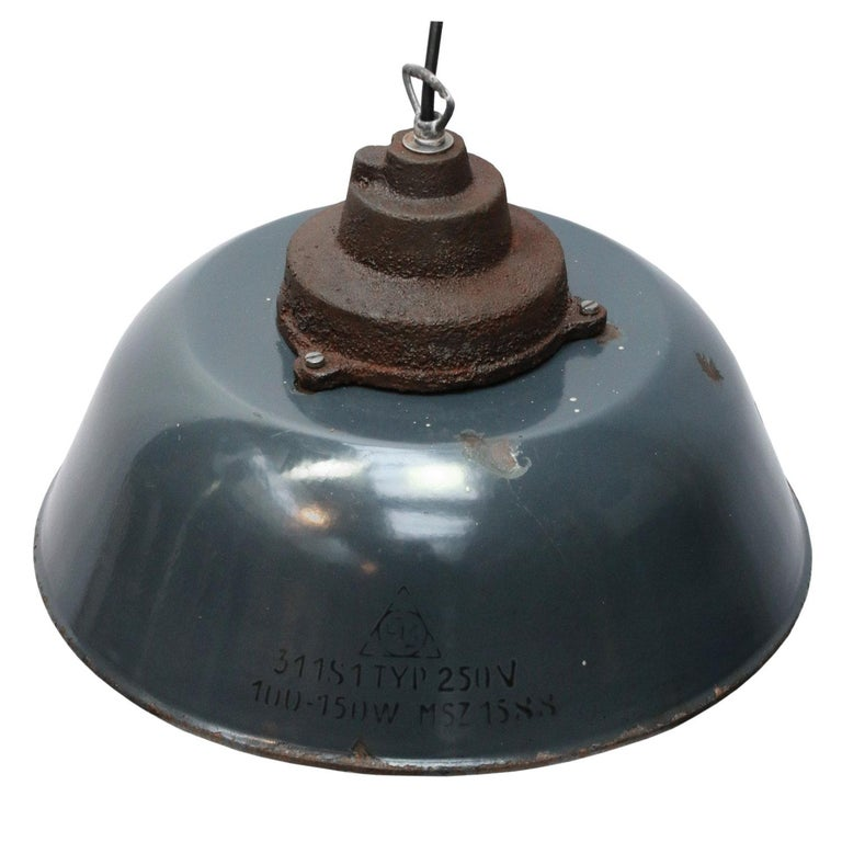 Factory pendant Dark blue enamel with white interior Rusty cast iron top.  Weight 3.20 kg / 7.1 lb  Priced per individual item. All lamps have been made suitable by international standards for incandescent light bulbs, energy-efficient and LED