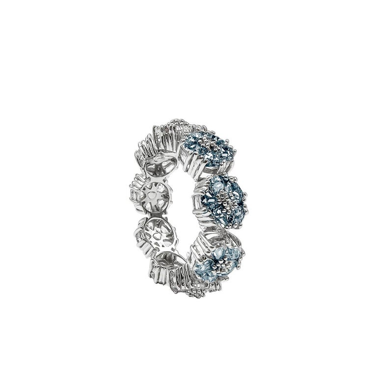 Designed in NYC  .925 Sterling Silver 5 x 10 mm Dark Blue Topaz Blossom Gemstone Trinity Ring. No matter the season, allow natural beauty to surround you wherever you go.  Blossom gemstone trinity ring:   Sterling silver band  High-polish