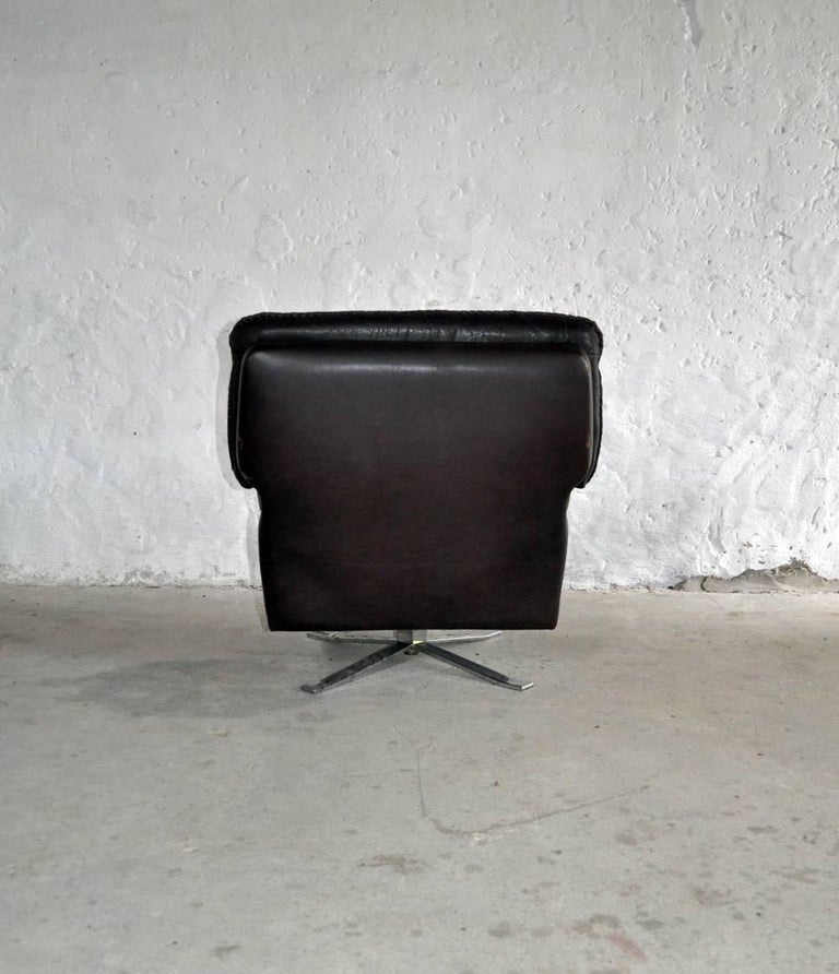 Mid-20th Century Dark Brown Leather and Chrome Lounge Chair and Stool by Arne Norell For Sale